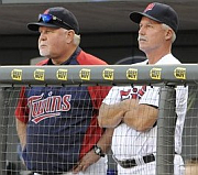 Ron Gardenhire and Rick Anderson watching Twins pitching.